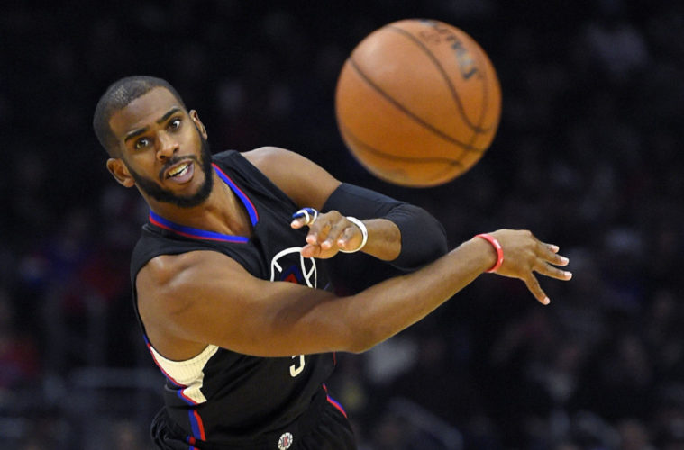 Los Angeles Clippers guard Chris Paul passes the ball during the first half of an NBA basketball game against the Sacramento Kings, Saturday, Jan. 16, 2016, in Los Angeles. (AP Photo/Mark J. Terrill)